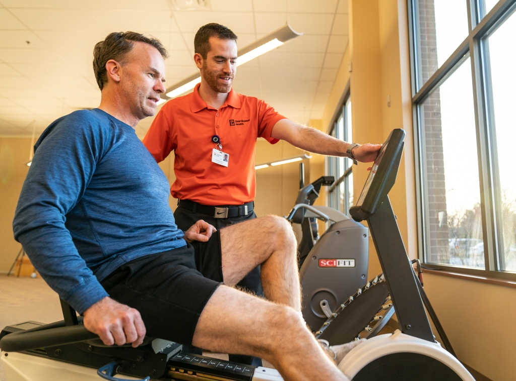Patient and trainer working out in Coordinated Health facility