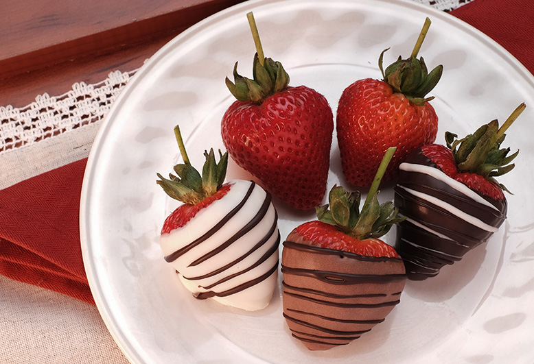 Chocolate covered strawberries on white plate Gertrude Hawk